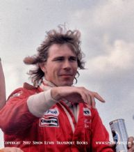 James Hunt (with beer can...) photo.  On his Lap Of Honour after winning British GP 1977